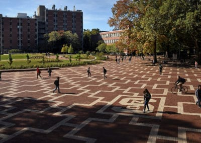 Students walk to class on North Campus at the Brickyard