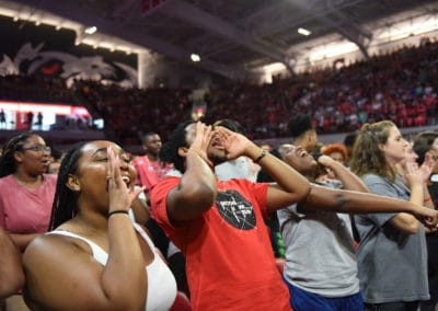 Students at the convocation at Reynolds Coliseum